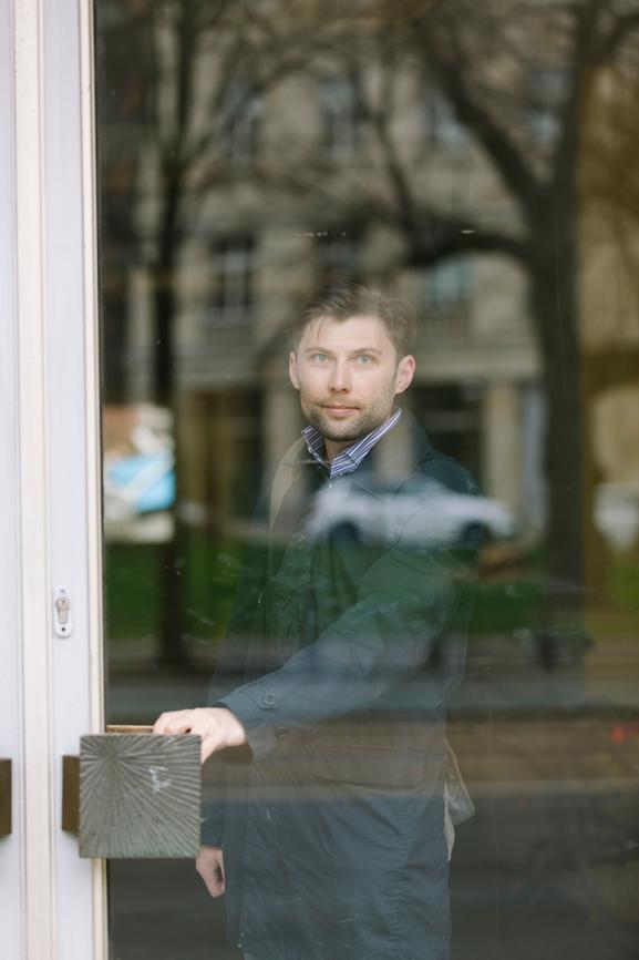 Portrait of young man  behind a door